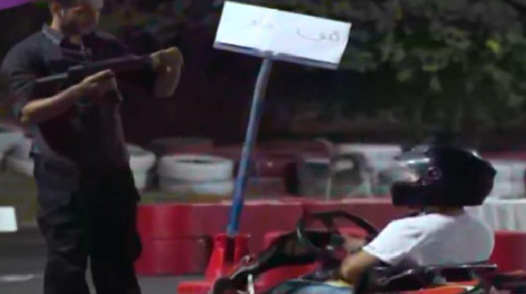 Prank sidekick holding a machine gun | Source: YouTube/OTV