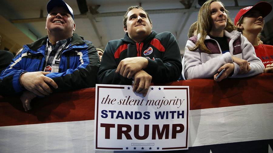 """At Donald Trump rallies, his campaign distributes signs heralding support from the """"silent majority."""" 