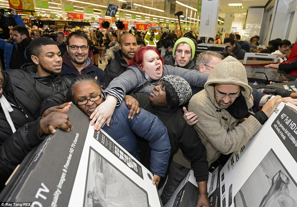 Customers push each other out of the way as the crowd surges towards widescreen televisions at the Asda store in Wembley   Source: TheDailyMail/RayTang/REX