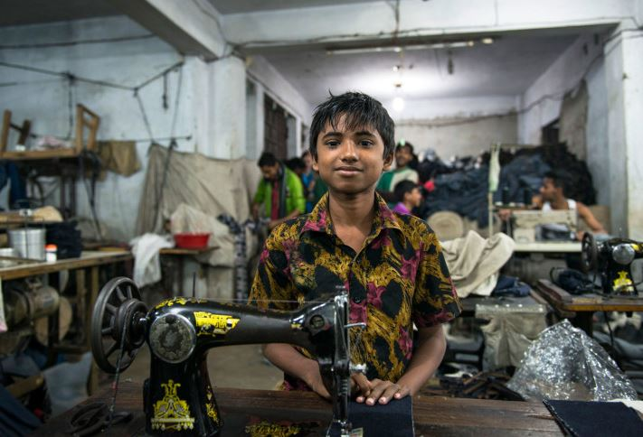 Young boy working in a Bangladesh sweatshop   Source: Ecoterre