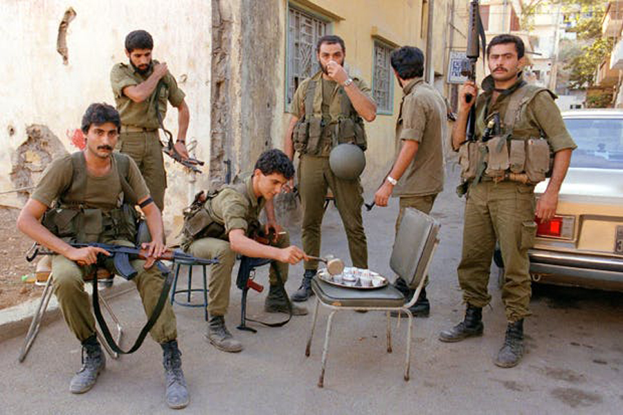 Six fighters of the Lebanese Force (LF) drink coffee during a break in the battle | Source: JOSEPH BARRAK/AFP/GettyImages